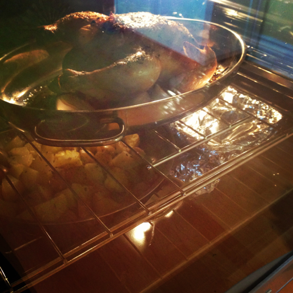 Chicken roasting and two sides in KitchenAid oven on eatlivetravelwrite.com
