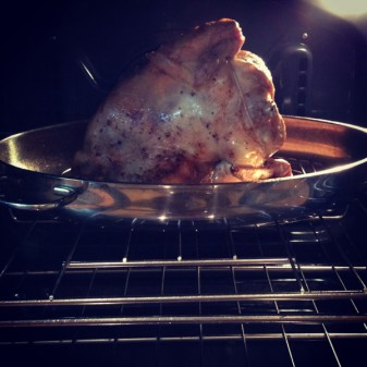 Chicken standing on its side in KitchenAid oven on eatlivetravelwrite.com