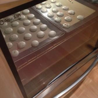 Macarons baking in a KitchenAid oven on eatlivetravelwrite.com