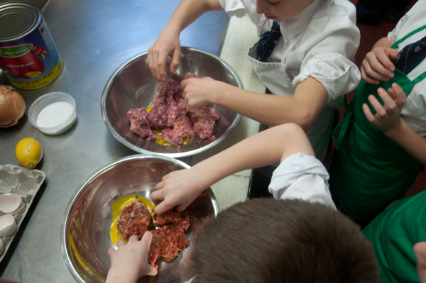 Kids making meatballs on eatlivetravelwrite.com