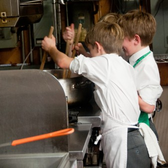 Les Petits Chefs stirring tomato sauce on eatlivetravelwrite.com