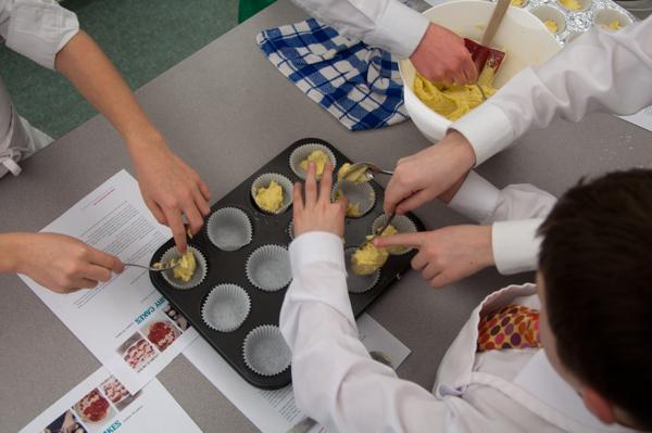 Filling cupcake pans on eatlivetravelwrite.com