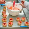 Jamie Oliver tea party fairy cakes being iced on eatlivetravelwrite.com