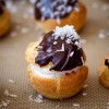 Choux puffs filled with jam and cream and topped with chocolate on eatlivetravelwrite.com
