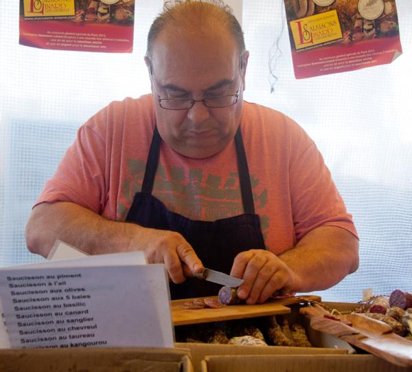 Saucisson seller at Marche Baudoyer on eatlivetravelwrite.com