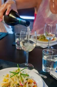 Pouring wine at La Cuisine Paris market class dinner on eatlivetravelwrite.com