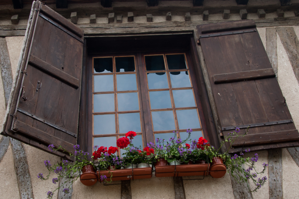 Window shutters in Gascony on eatlivetravelwrite.com
