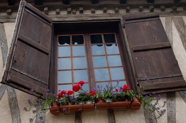 Window shutters in Gascony on eatlivetravelwrite.com