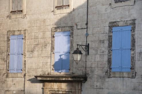 Blue window shutters in Neffies on eatlivetravelwrite.com