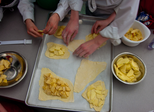 Kids making apple tartlettes on eatlivetravelwrite.com