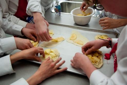 Kids making Jamie Oliver apple tartlettes on eatlivetravelwrite.com