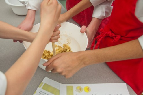 Kids mixing butter and sugar on eatlivetravelwrite.com