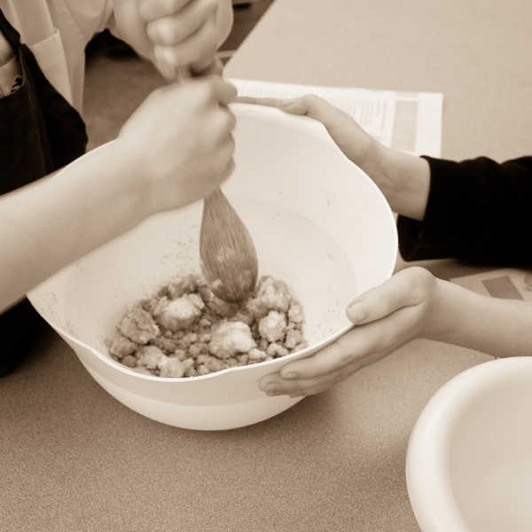 Kids mixing butter and sugar for cookies on eatlivetravelwrite.com