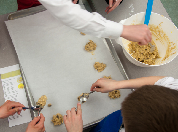 Kids scooping cookies on eatlivetravelwrite.com