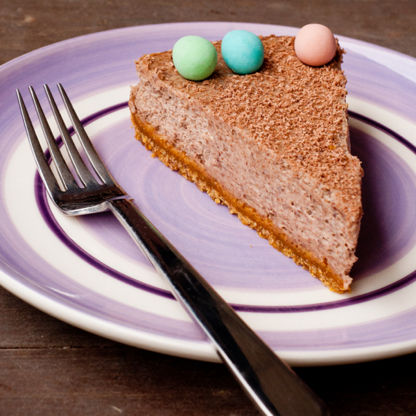 A slice of baked chocolate cheesecake on eatlivetravelwrite.com
