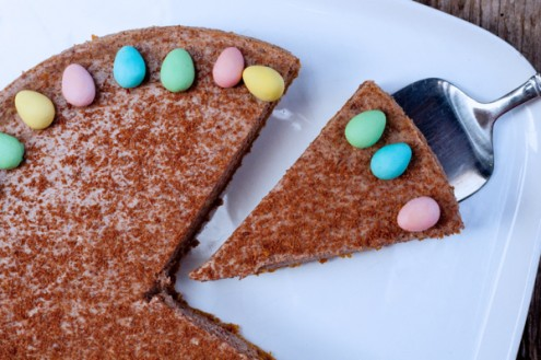 Easter decorations on a baked chocolate cheesecake on eatlivetravelwrite.com