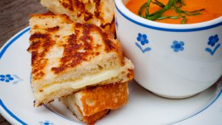 Creamy tomato soup and grilled cheese sandwiches