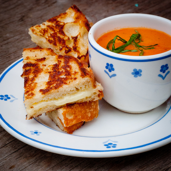 Creamy tomato soup with ultimate grilled cheese on eatlivetravelwrite.com