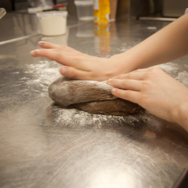 Kids kneading pasta dough on eatlivetravelwrite.com
