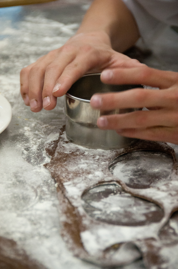 Kids cutting out chocolate raviolis filled with mascarpone and honey on eatlivetravelwrite.com
