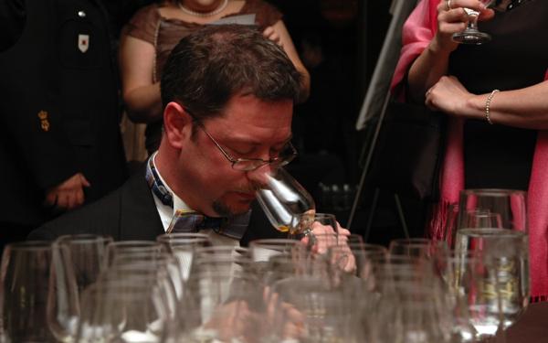 Neil Phillips tasting wine on eatlivetravelwrite.com