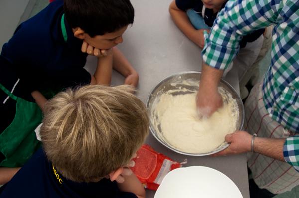 Massimo Bruno showing kids how to make pizza dough on eatlivetravelwrite.com