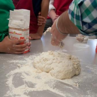 Massimo Bruno making pizza dough with kids on eativetravelwrite.com