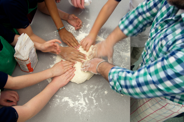 Kids feeling pizza dough on eatlivetravelwrite.com