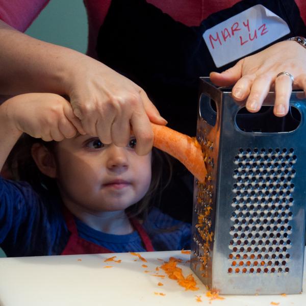 Kids grating carrots on eatlivetravelwrite.com