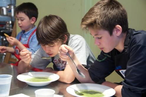 Kids enjoying Jamie Oliver garden glut soup on eatlivetravelwrite.com