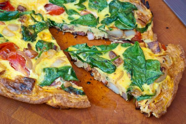 Breakfast frittata slice on eatlivetravelwrite.com