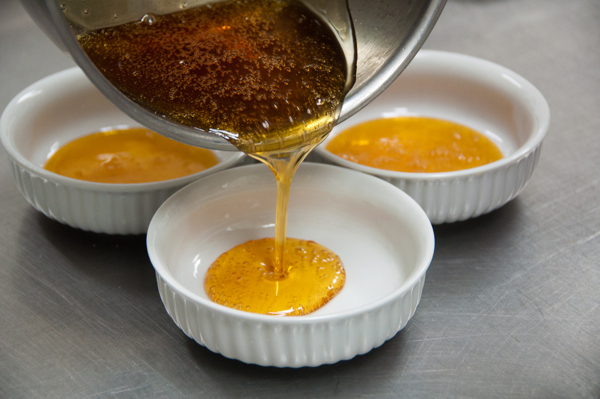 Pouring caramel for tarte tatins on eatlivetravelwrite.com