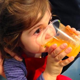 Enjoying orange smoothie on Food Reovlution Day on eatlivetravelwrite.com