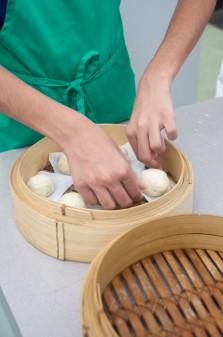 Kids preparing steamed buns for steaming on eatlivetravelwrite.com