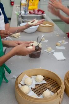 Kids assembling steamed red bean pste buns on eatlivetravelwrite.com
