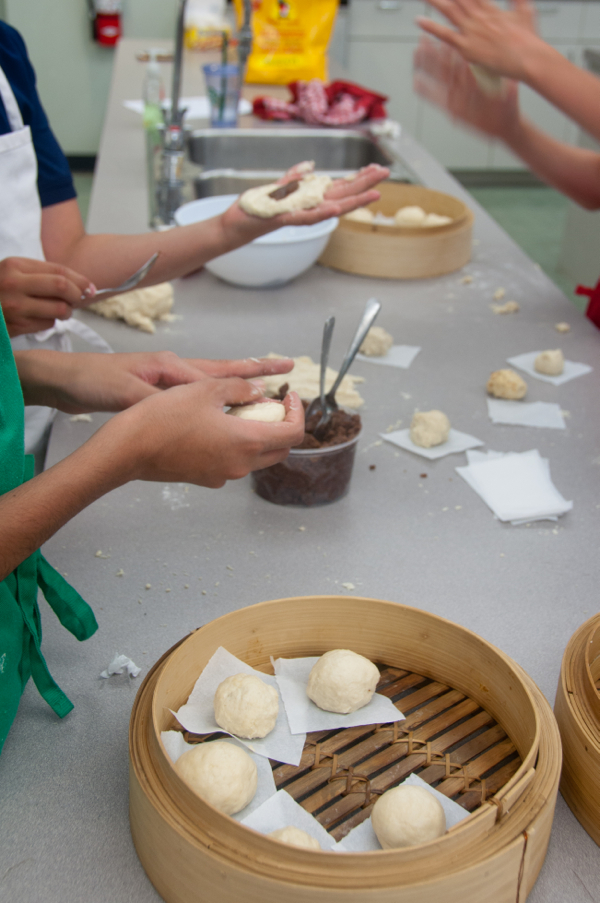 Kids assembling steamed red bean pste buns on eatlivetravelwrite.com