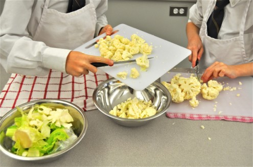 Kids chopping cauliflower on eatlivetravelwrite.com