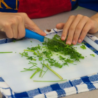 Kids chopping cilantro on eatlivetravelwrite.com
