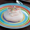 Pavlova topped with whipped cream and sprinkles on eatlivetravelwrite.com