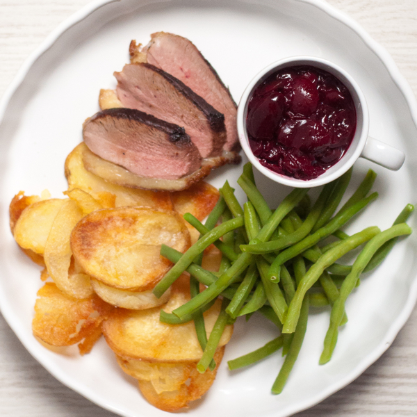 Duck with red-wine cherry sauce on eatlivetravelwrite.com