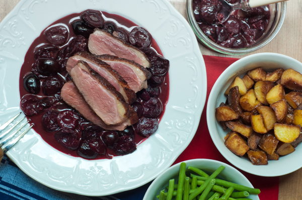 Duck with a red wine cherry sauce with green beans and roasted potatoes on eatlivetravelwrite.com
