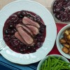 Duck breast with a red wine cherry sauce with green beans and roasted potatoes on eatlivetravelwrite.com