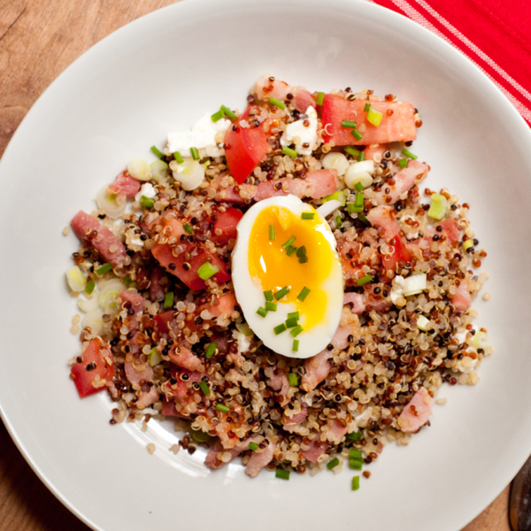 Quinoa breakfast bowl with egg and bacon on eatlivetravelwrite.com