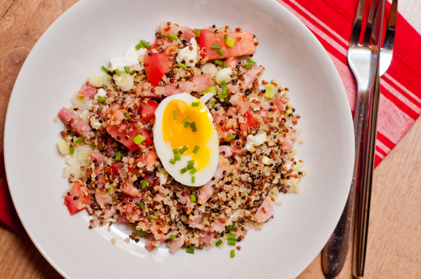 Quinoa breakfast bowl with bacon and egg on eatlivetravelwrite.com