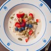 Peanut butter overnight thick cut oats with berries and seeds on eatlivetravelwrite.com