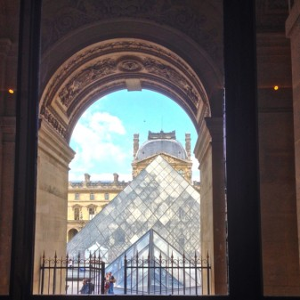 Looking out on the Pyramide from inside the Louvre on THATLou on eatlivetravelwrite.com