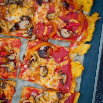Gluten free Polenta pizza with mushrooms and roasted red peppers on eatlivetravelwrite.com