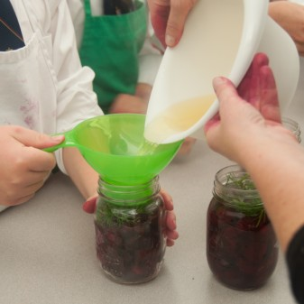 Pouring pickling sirop on beets on eatlivetravelwrite.com