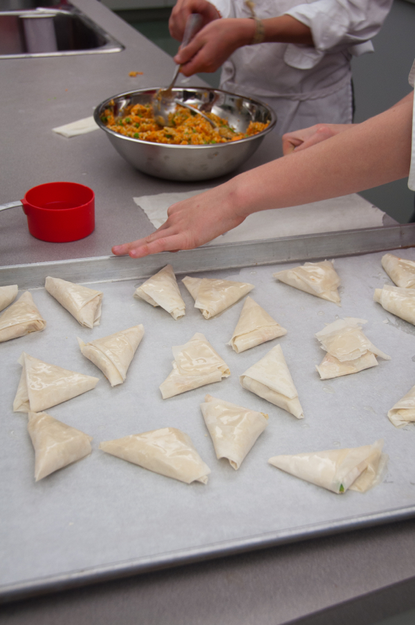 Assembling sweet potato samosas on eatlivetravelwrite.com