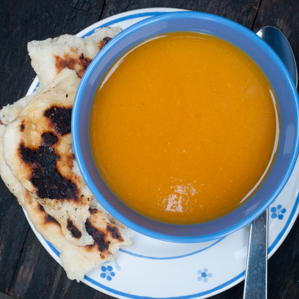 Slow cooker curried squash soup with naan on eatlivetravelwrite.com